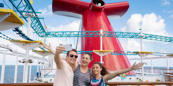 Family Posing in Front of Ships Funnel (Photo: Carnival Cruise Line)