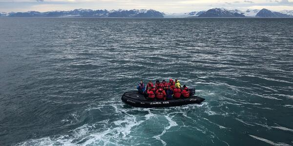 Tauck Travel passengers, traveling on Ponant's Le Boreal, set off on a Zodiac glacier excursion (Photo: Chris Gray Faust)