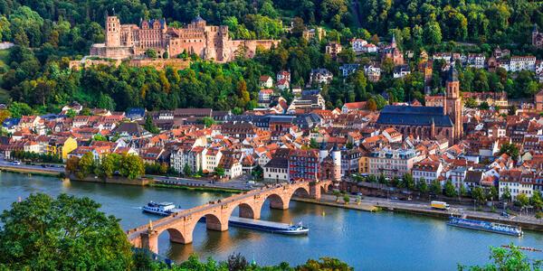 Aerial shot of cruise ships sailing past Heidelberg