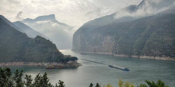 Ships in the slightly foggy Qutang Gorge on Yangtze river