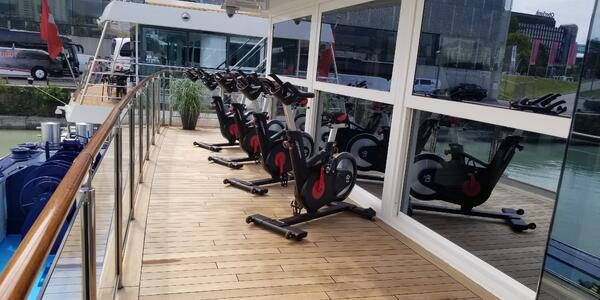 Row of spin bikes on the exterior deck on AmaMagna