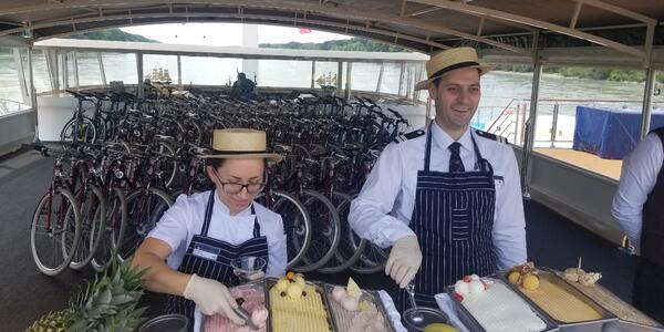 Two staff members serving gelato on the sun deck of AmaMagna