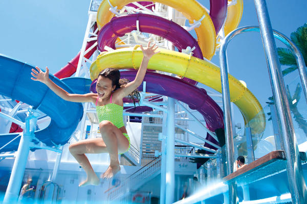 Young girl jumping into a pool at the water park on Norwegian Breakaway