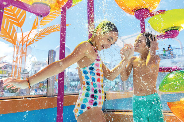 Two kids playing in the water at the Splash Pad on Navigator of the Seas