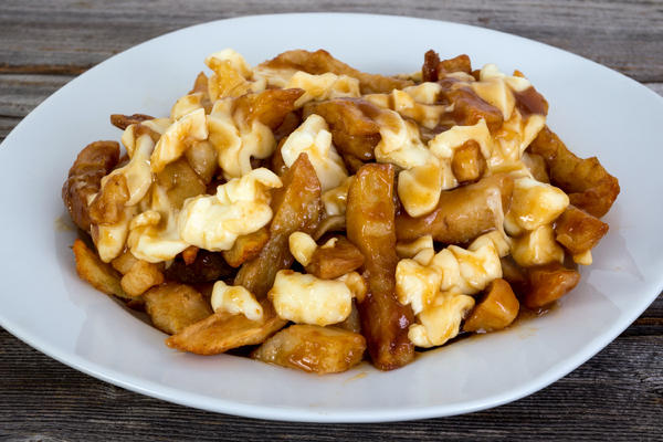 Quebec's Delicacy Poutine Which is Gravy and Fries (Photo: julie deshaies/Shutterstock)