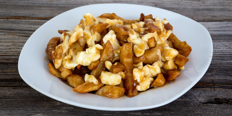 Quebec's Delicacy Poutine Which is Gravy and Fries (Photo: julie deshaies/Shutterstock))
