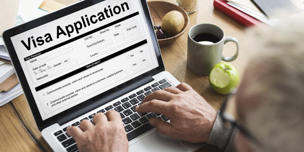 Man Filling out Online Visa Application (Photo: Rawpixel.com/Shutterstock)