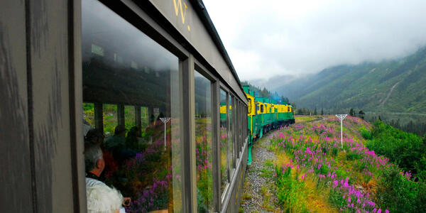Passengers riding the White Pass Railway from Skagway to the Yukon Territory