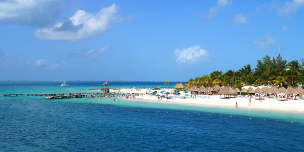 View of sunny Isla Mujeres, Mexico from the water (Photo: halfofmoon/Shutterstock.com)