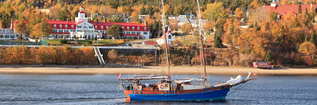 The Scenic Tadoussac Village, with Fall Foliage and a Boat on Rivière Saguenay (Photo: Bildagentur Zoonar GmbH/Shutterstock)
