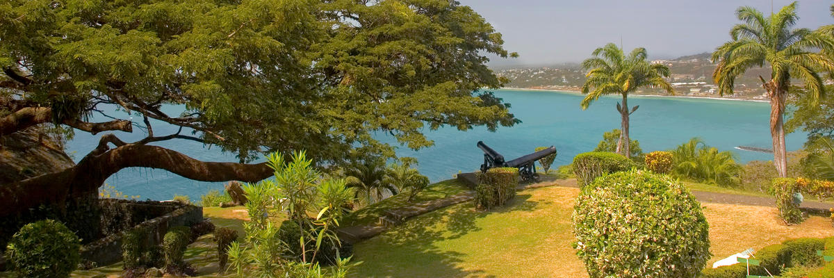 Scarborough, Tobago, Showcasing Blue Waters and Scenic Scenery (Photo: Chr. Offenberg/Shutterstock)