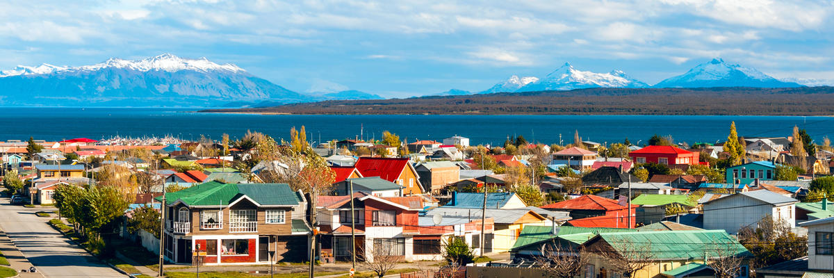 Strait Of Magellan, Puerto Natales, Patagonia, Chile, With Vibrant Houses and Mountainscapes in Distance (Photo: Ksenia Ragozina/Shutterstock)