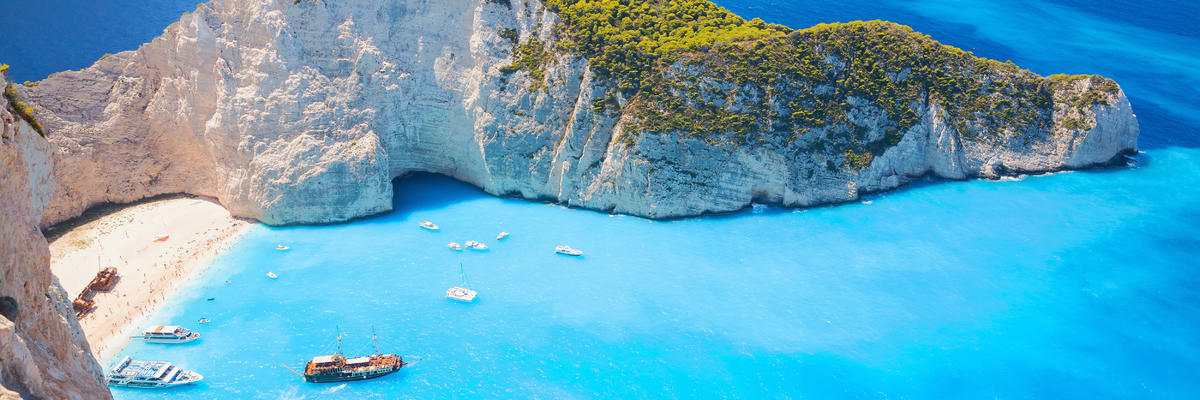 Zakynthos, The Greek Island in the Ionian Sea, With Crystal Waters and Mountainscapes (Photo: Evannovostro/Shutterstock)
