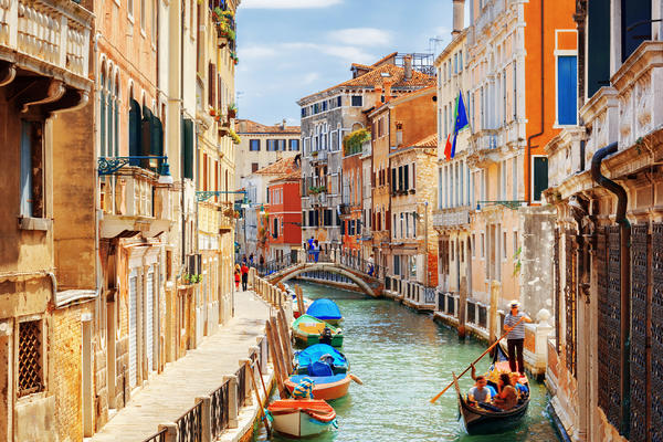 View of the Rio Marin Canal with Boats and Gondolas from the Ponte de la Bergami in Venice, Italy (Photo: Efired/Shutterstock)