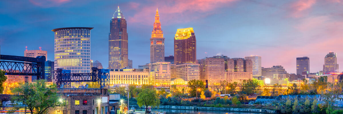Cleveland, Ohio, USA skyline on the Cuyahoga River at sunset