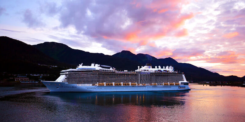 Exterior shot of Ovation of the Seas in Alaska at sunset