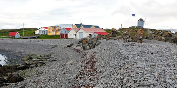 Houses and Windmill in Vigur Island on a Windy Day, Iceland (Photo: Luigi Morbidelli/Shutterstock)