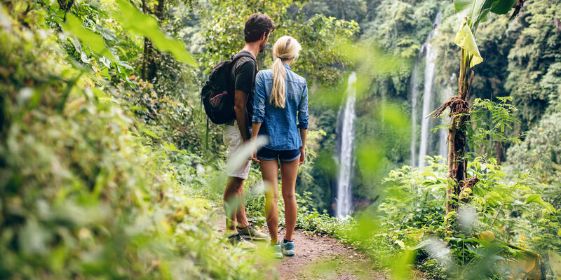 Couple Hiking in the Amazon, Overlooking Waterfall (Photo: Jacob Lund/Shutterstock)