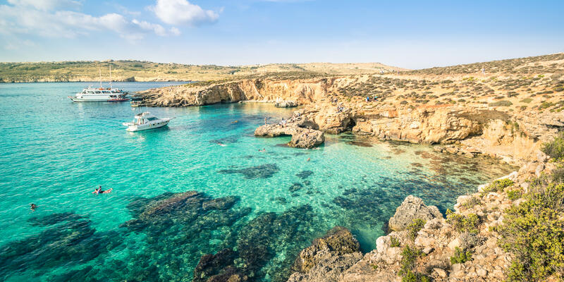 People Snorkeling in the Blue Lagoon in Comino Island, the Mediterranean Natural Wonder in the Beautiful Malta (Photo: View Apart/Shutterstock)