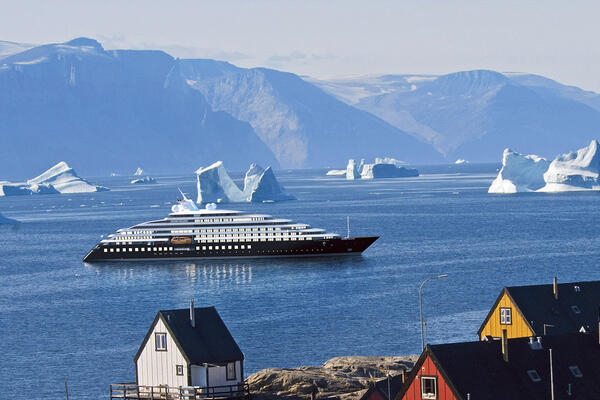 Exterior shot of Scenic Eclipse cruising the Northwest Passage coastline