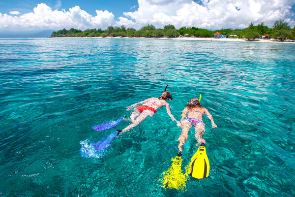 Two Women Snorkeling in the Bahamas (Photo: Dudarev Mikhail/Shutterstock)