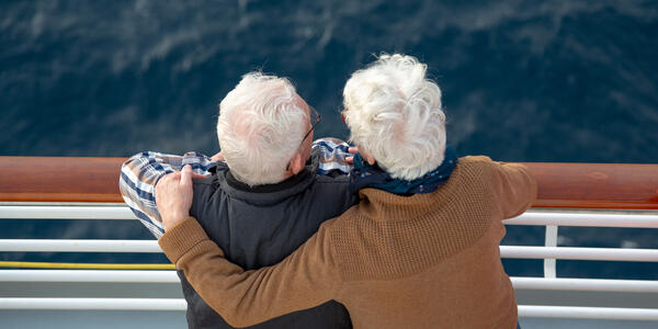 Aerial shot of a senior couple on a cruise in the fall