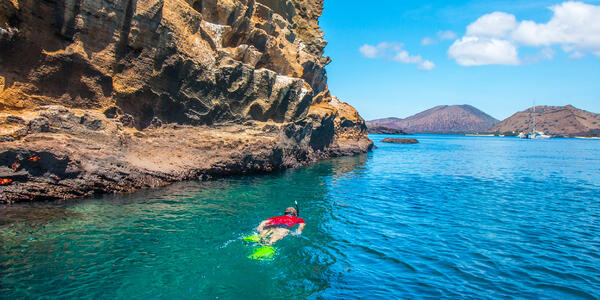 A Man Swims Near the The Galapagos Islands (Photo: FOTOGRIN/Shutterstock)