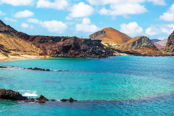 View of an Underwater Crater in the Foreground with Pinnacle Rock in the Background, on Bartolome Island in the Galapagos Islands (Photo: Jess Kraft/Shutterstock)