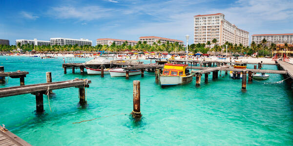 Dock on Palm Beach, Aruba on a Sunny Spring Afternoon (Photo: Jo Ann Snover/Shutterstock)