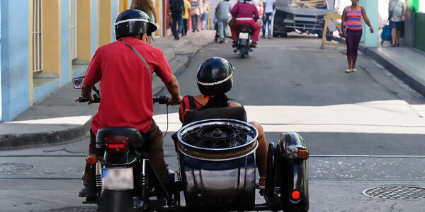 Man and woman on a sidecar bike for a sidecar tour in Cuba