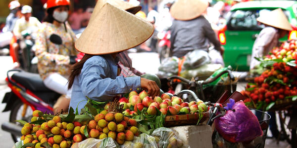 Vendors selling fruits and veggies by bike in Ho Chi Mihn City
