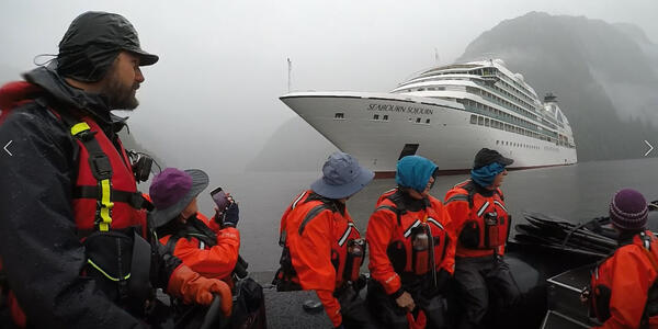 A Zodiac takes Seabourn Sojourn passengers to their kayaks for a Ventures by Seabourn excursion in Alaska's Misty Fjord. (Photo: Ashley Kosciolek)