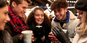 Friends Socializing in the Christmas Market (Photo: Monkey Business Images/Shutterstock)