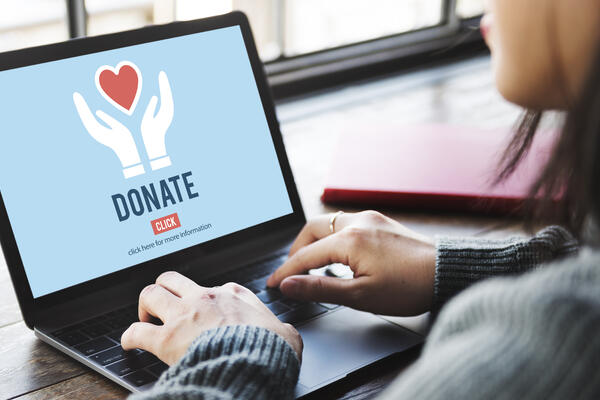Woman donating to charity online from a laptop (Photo: RawPixel.com/Shutterstock)