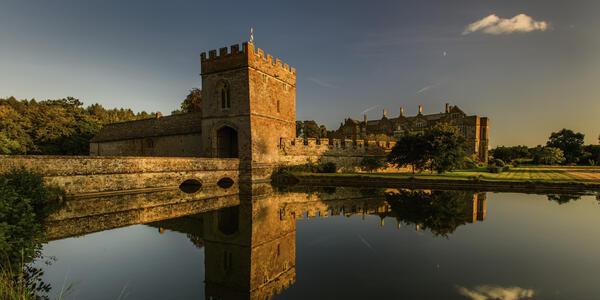 Moody exterior shot of the Broughton Castle at sunset