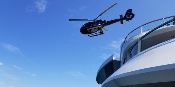One of Scenic Eclipse's helicopters lifting off the ship (Photo: Colleen McDaniel)