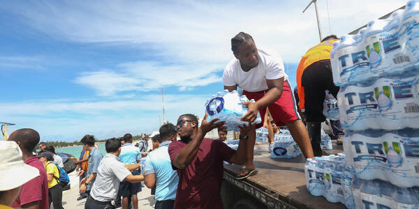 Royal Caribbean crewmembers unloadeding water, meals and relief supplies at Grand Bahama