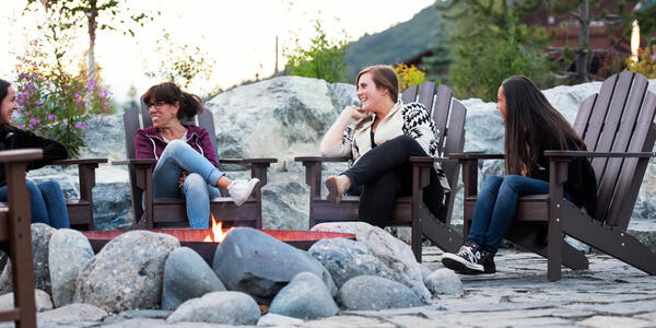 Guests chatting on the fireside patio at the Mt. McKinley Princess Wilderness Lodge (Photo: Princess Cruises)