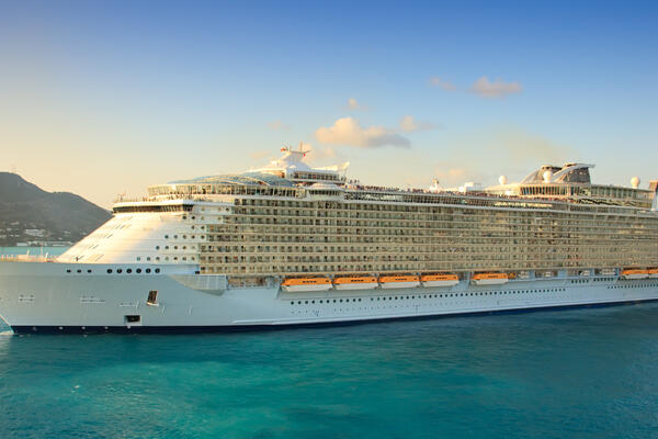Cruise ship in the blue Caribbean waters at sunset