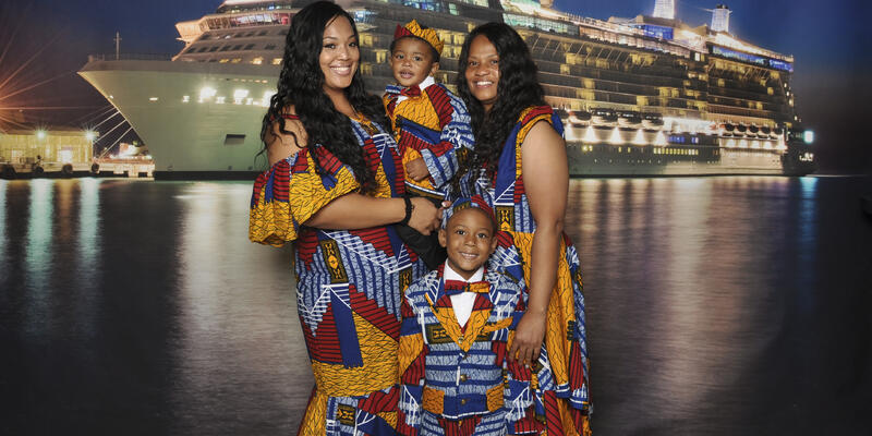 Family dressed in African Attire for the annual Africa Night, a celebration of the African diaspora onboard Festival at Sea (Photo: Festival at Sea/Blue World Travel Corp.)