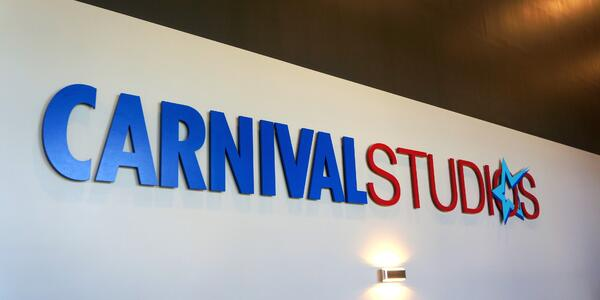 The blue and red sign for Carnival Studios