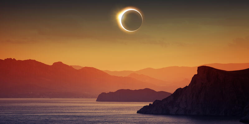 Astronomical phenomenon, depicting a full total solar eclipse with mountains and sea (Photo: IgorZh/Shutterstock)