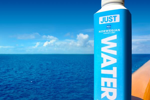 Water bottle packaged water in plant-based cartons by JUST Goods, Inc. (Image: Norwegian Cruise Line)