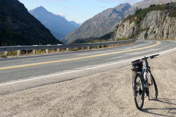 A bike in view on Skagway's Alaskan bike tour, surrounded by scenic views of the mountains in the distance (Photo: Chris Gray Faust/Cruise Critic)