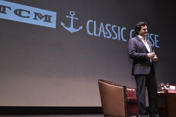 Ben Mankiewicz, primetime host on the cable channel Turner Classic Movies, giving a talk on the Turner Classic Movies Cruise (Photo: TCM Cruise/ WarnerMedia, LLC.)
