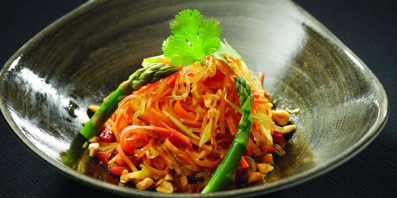 Close-up shot of a plant-based asparagus and noodle salad