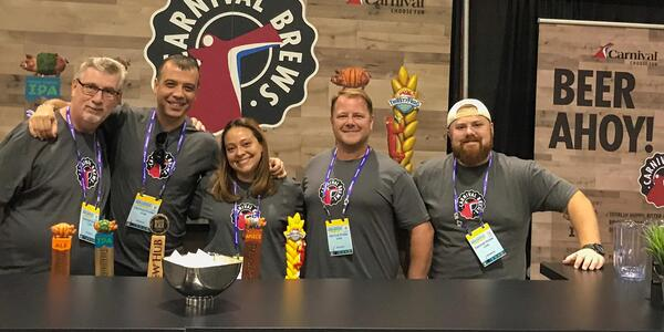 Group of Carnival Cruise Line brewers smiling at the Great American Beer Festival