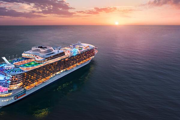 Aerial rendering of Royal Caribbean's Wonder of the Seas sailing at sunset