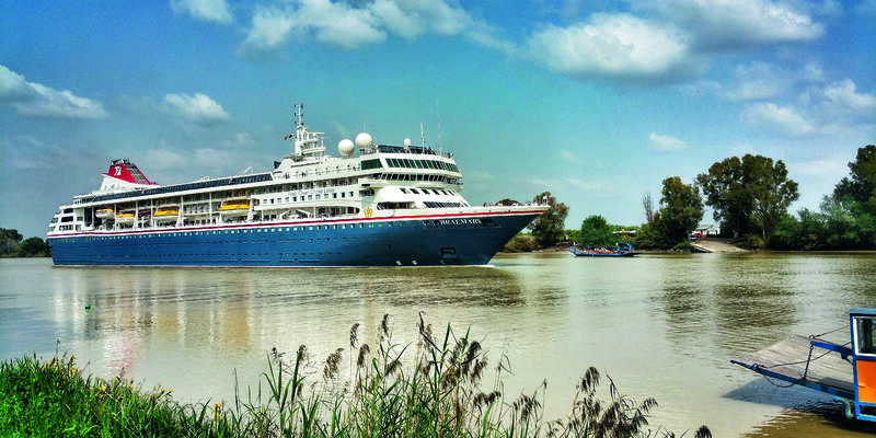Wide shot Fred. Olsen's Braemar cruising through Coria del Río near Seville, Spain (Photo: Fred. Olsen Cruise Lines)