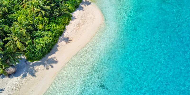 Aerial photo of beautiful paradise Maldives tropical beach on island. (Photo: Jag_cz/Shutterstock)